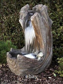 Curving Log Fountain Inc Light Relic Unique Water Feature Par Henri Studio