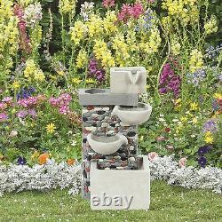 Fontaine D'eau En Cascade Avec Jardin Mural De Galets